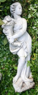 Concrete Statue Of A Woman With Cornucopia