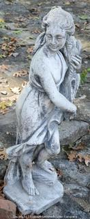 Concrete Statue Of A Woman Holding Wheat