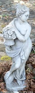 Concrete Statue Of A Woman Holding Flowers