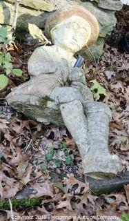 Statue Of A Boy Who Sits On A Wall
